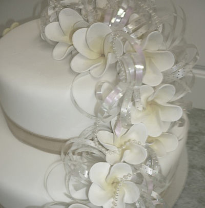 Cake with ribbon and pearls.